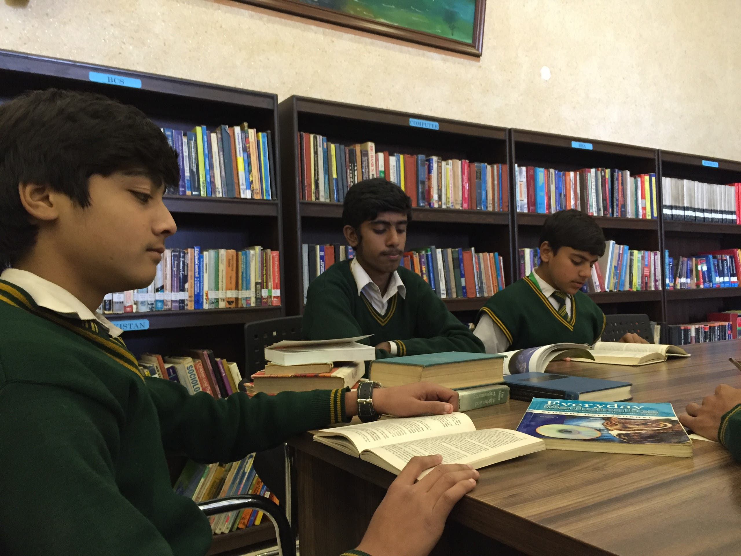 Army Public School students studying inside library. (Supplied)