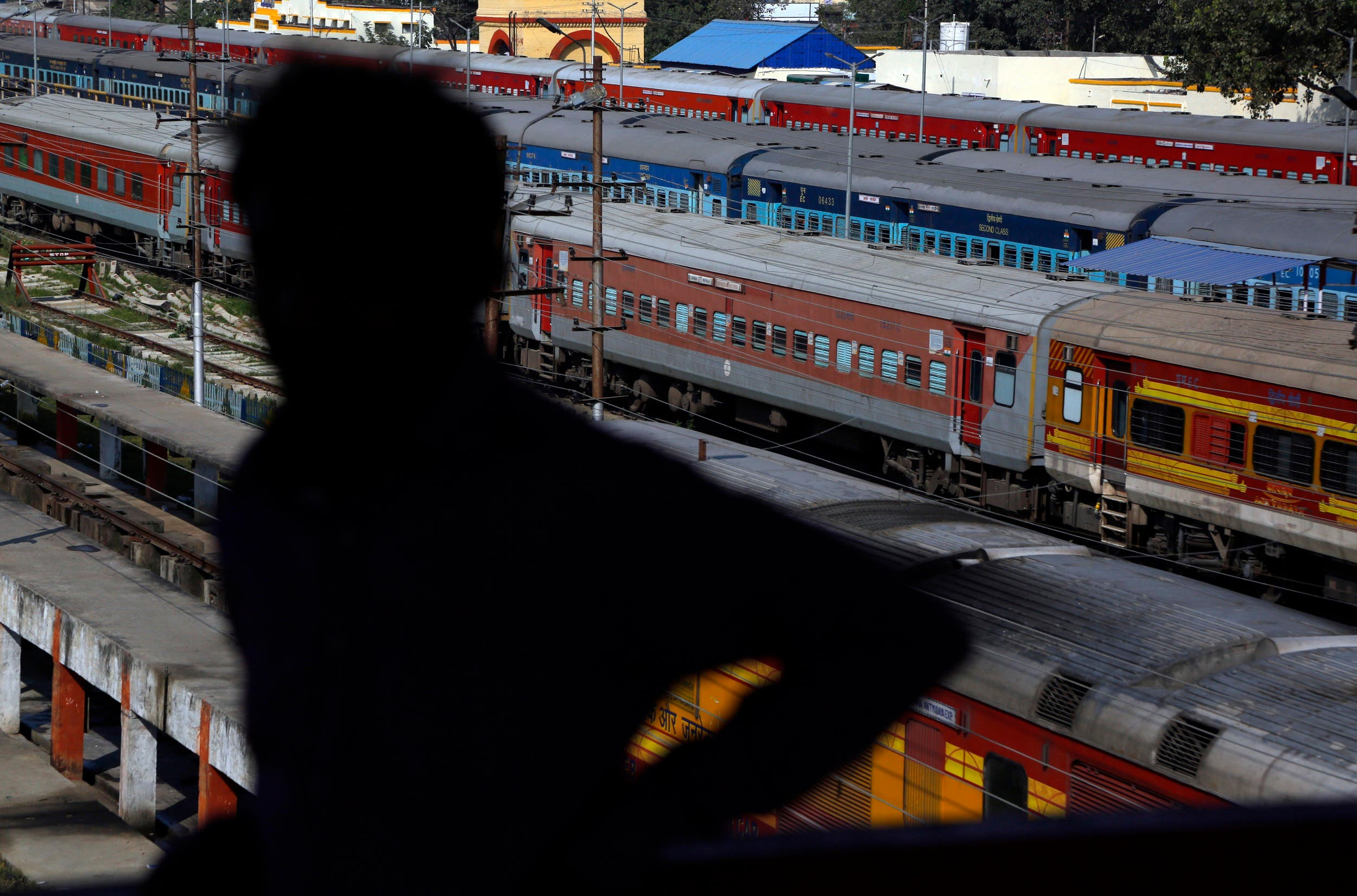 In this Nov. 29, 2018 photo, an Indian man stands at Jayanagar train station in India from where a 34 kilometers long rail track connects to Janakpur in southeastern Nepal. (AP)
