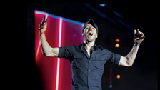 An energetic Enrique Iglesias interacts with audience during Riyadh concert
