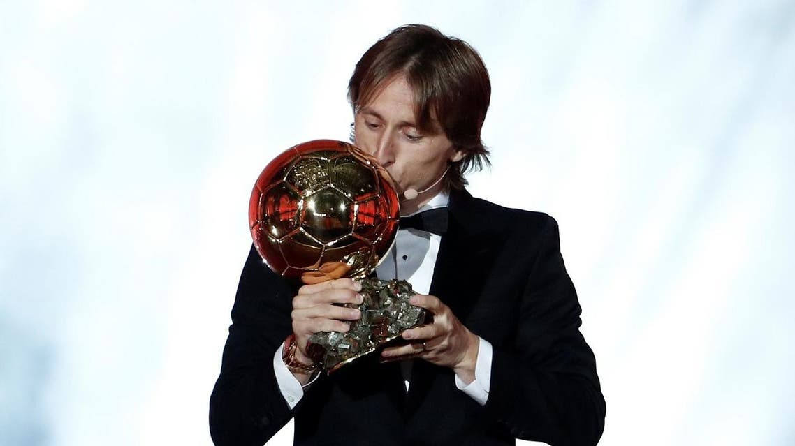 Real Madrid's Luka Modric with the Ballon d'Or award. (Reuters)