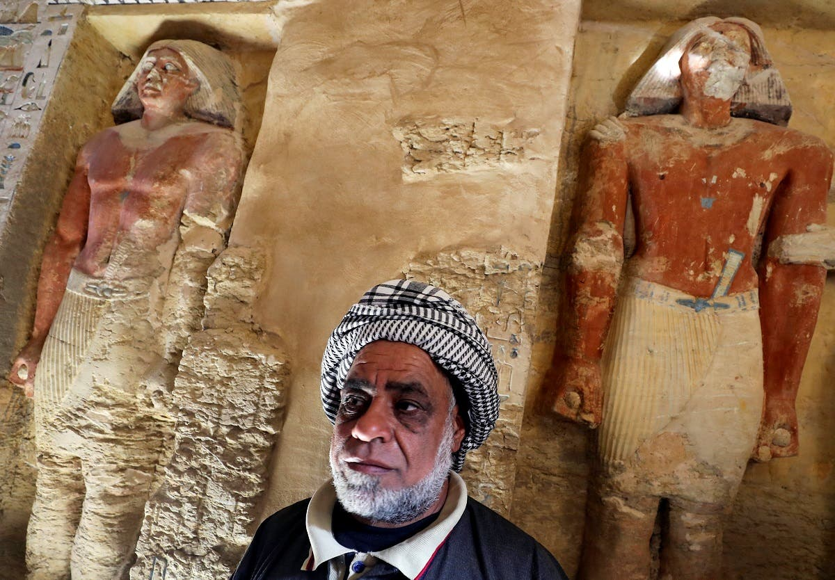 An Egyptian archaeological worker stands inside the newly-discovered tomb of 'Wahtye', which dates from the rule of King Neferirkare Kakai, at the Saqqara area near its necropolis, in Giza. (Reuters)