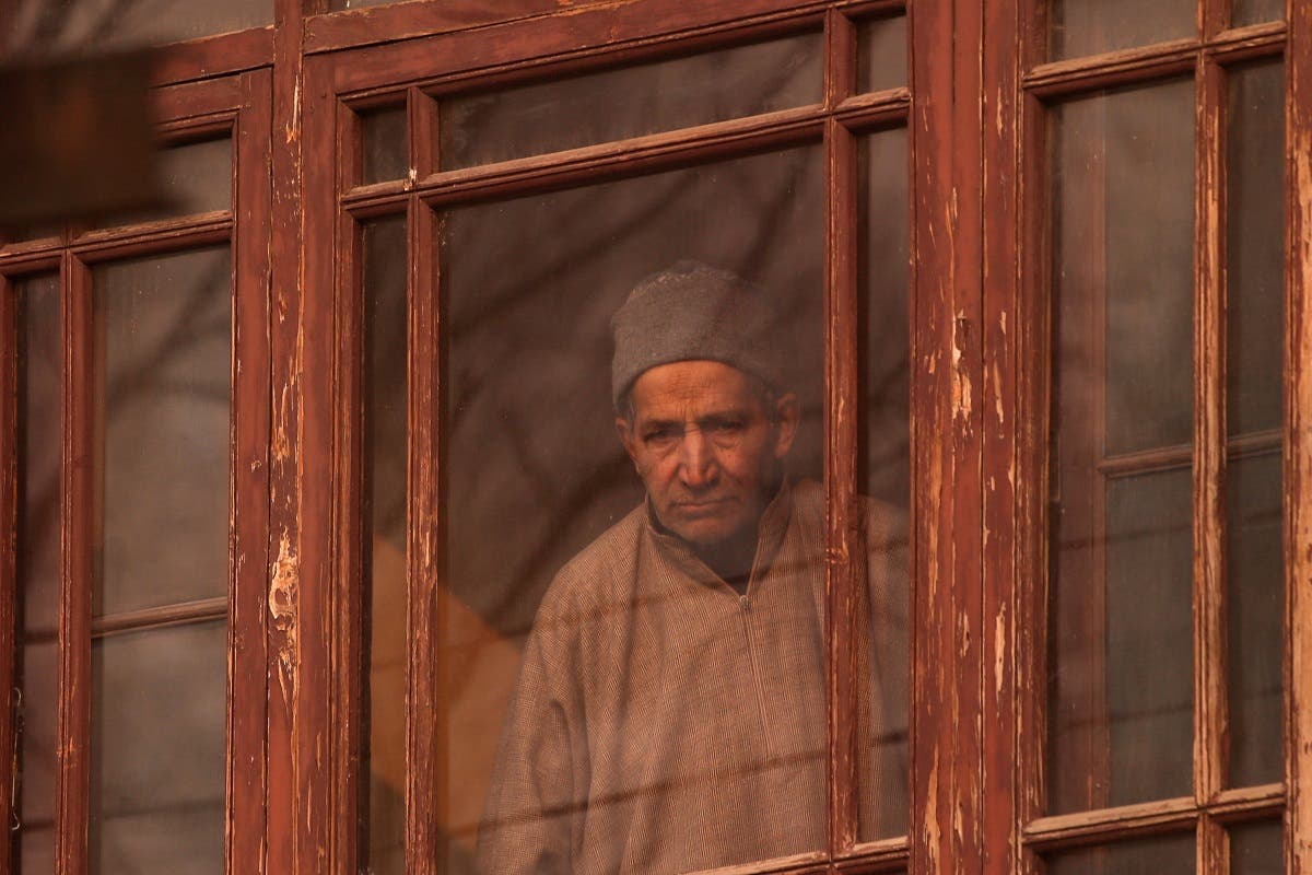A man looks out from a window of a house during a strike called by Kashmiri separatists against the recent killings in Kashmir, in Srinagar. (Reuters)