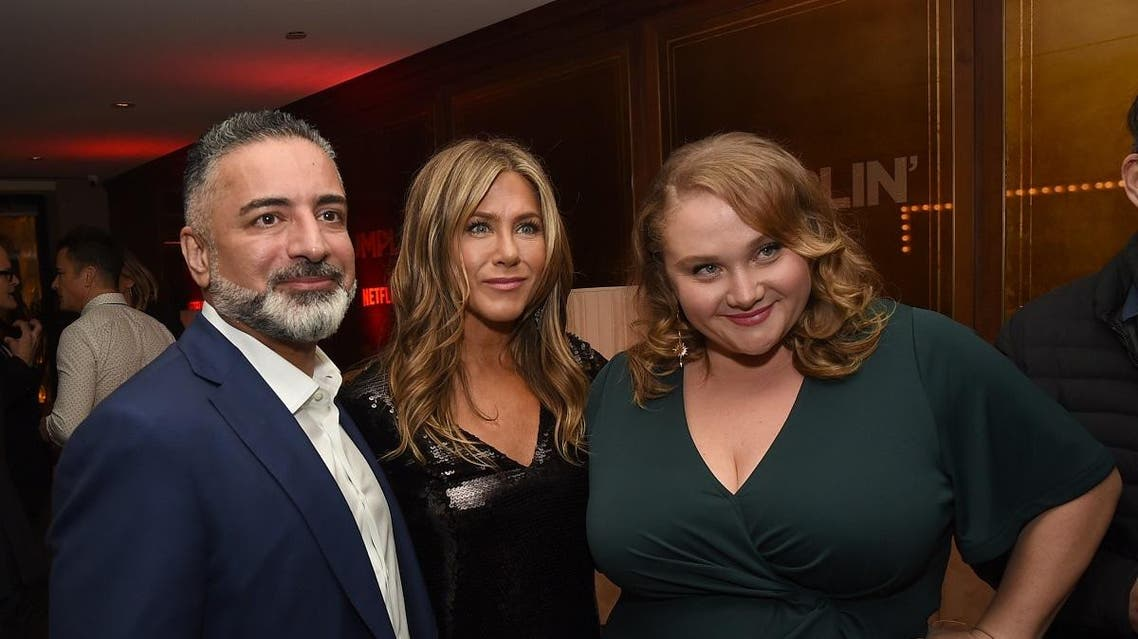 "Mohamed AlRafi, Jennifer Aniston and Danielle MacDonald pose at the after party for the premiere of Netflix's ""Dumplin'"" at Sunset Tower. (AFP)"