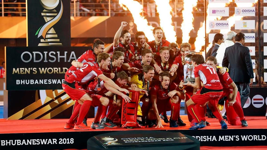 Belgium players celebrate with the winners trophy after their win over Netherlands in the Men's Hockey World Cup finals at Kalinga Stadium in Bhubaneswar, India. (Reuters)