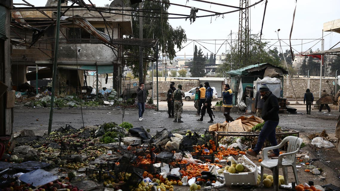 Civilians and Syrian rebel fighters gather after a car bomb reportedly exploded near a position of pro-Turkey fighters in a market in the northern Syrian city of Afrin on December 16, 2018. A car bomb killed at least eight people including four civilians near a pro-Turkey rebel post in the northern Syrian city of Afrin, a British-based war monitor said.