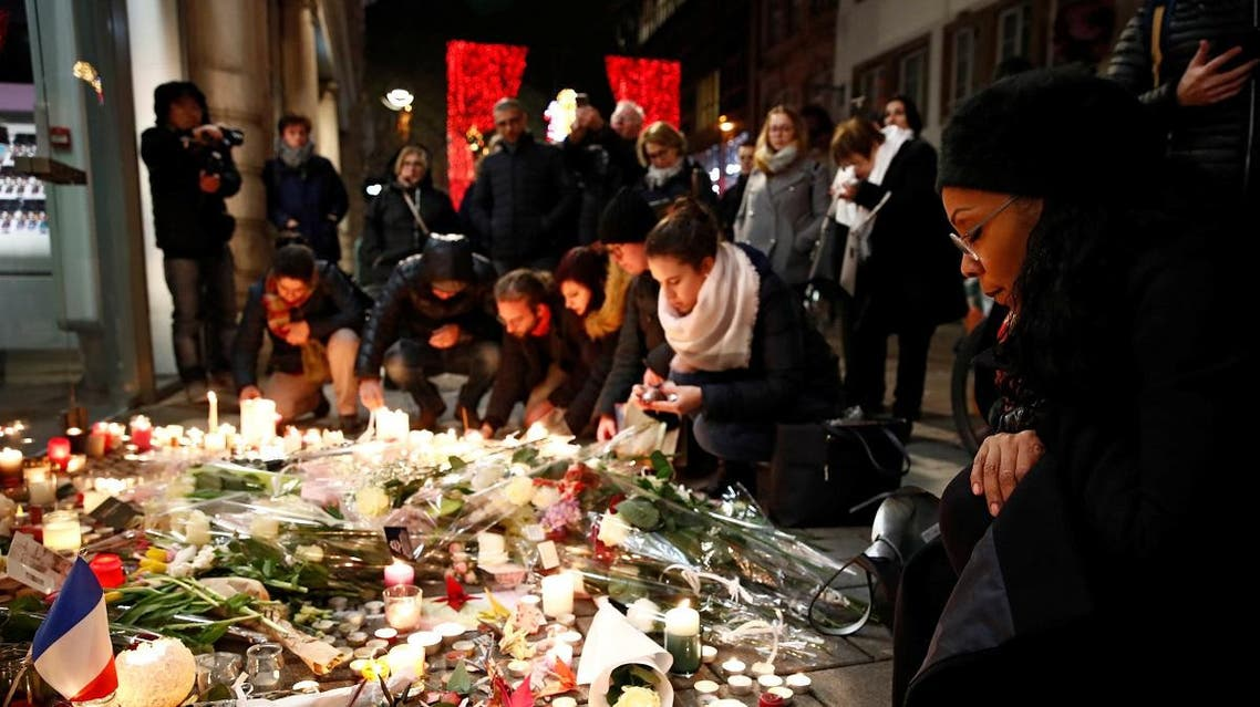People cry as they light candles in tribute to the victims of the deadly shooting in Strasbourg. (Reuters)