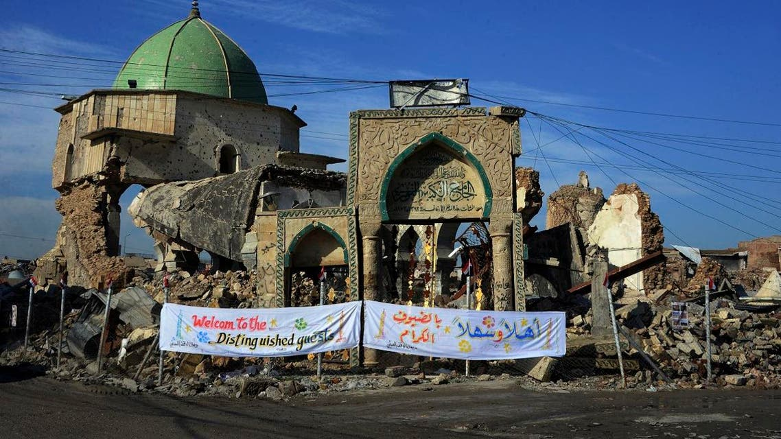 """The Great Mosque of al-Nuri and the remains of """"Al-Hadba"""" leaning minaret in Mosul's war-ravaged Old City, during the placing of the corner stone ceremony. (AFP)"""