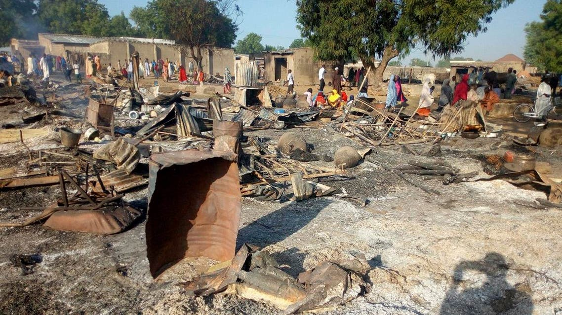 People gather at the site of an attack in Maiduguri, Nigeria, Thursday, Nov. 1, 2018, after dozens of attackers overpowered soldiers guarding the camp and fighting continued for about two hours. (AP)