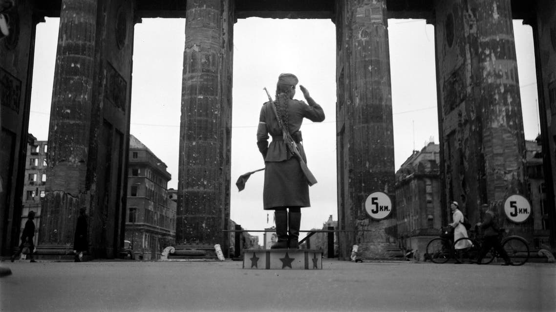 A Soviet Red army woman soldier controls traffic in front of the Brandenburg Gate in July 1945 in Berlin. (AFP)