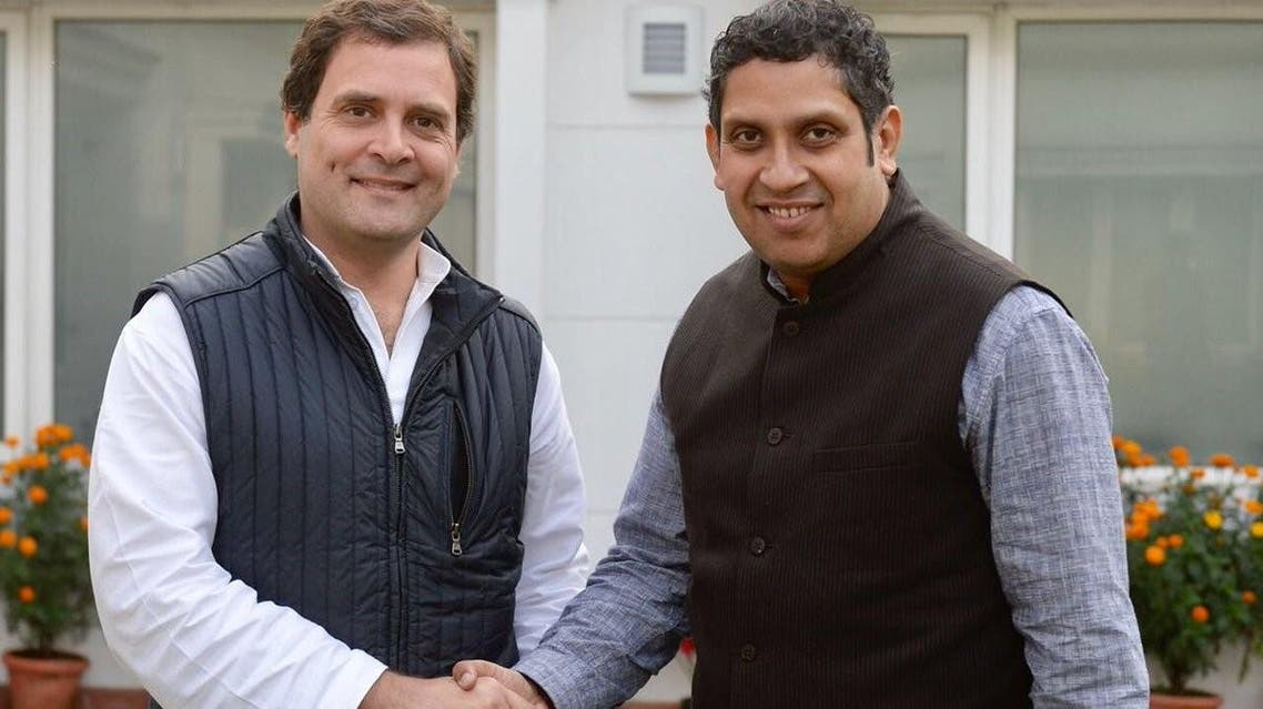 Praveen Chakravarty (right) with Congress Party chief Rahul Gandhi. (Suplied)