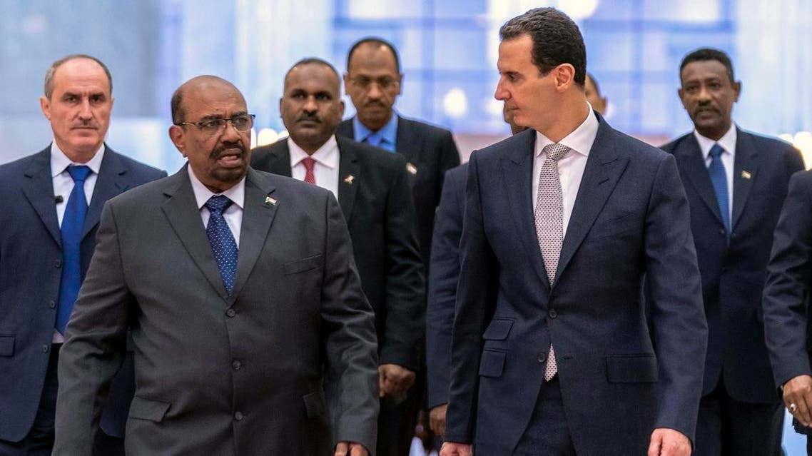 In this photo released by the Syrian official news agency SANA, Syrian President Bashar Assad, right, meets with Sudan's President Omar al-Bashir in Damascus, Syria. (SANA via AP)