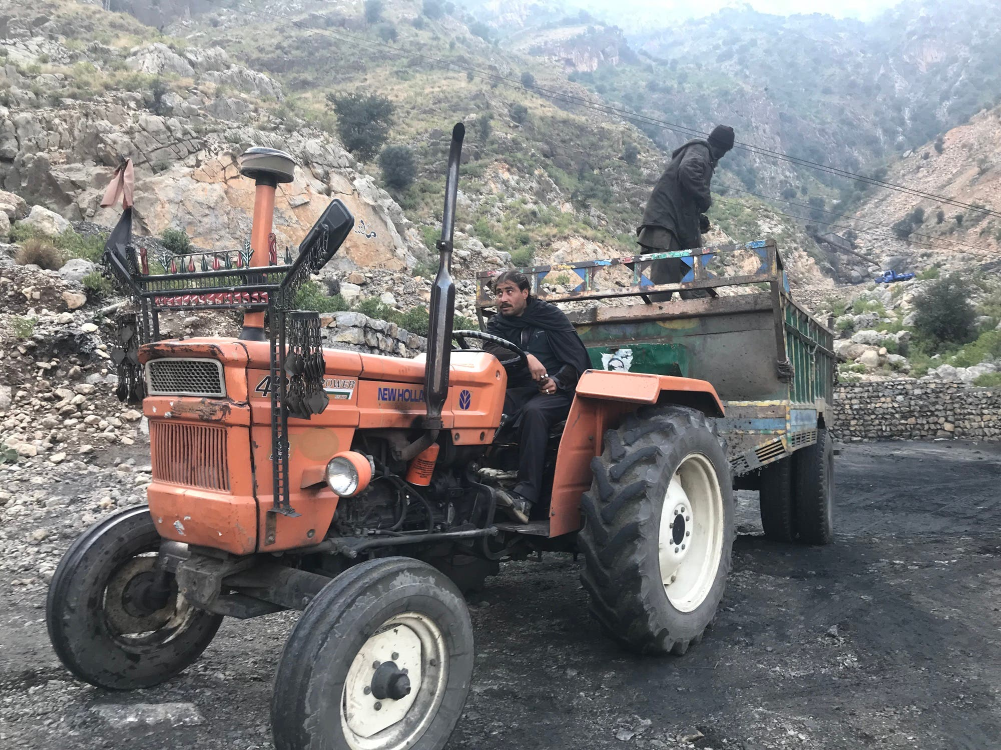 Tractors being used to transport coal from the mine to market at Darra Adam Khel. (Supplied)