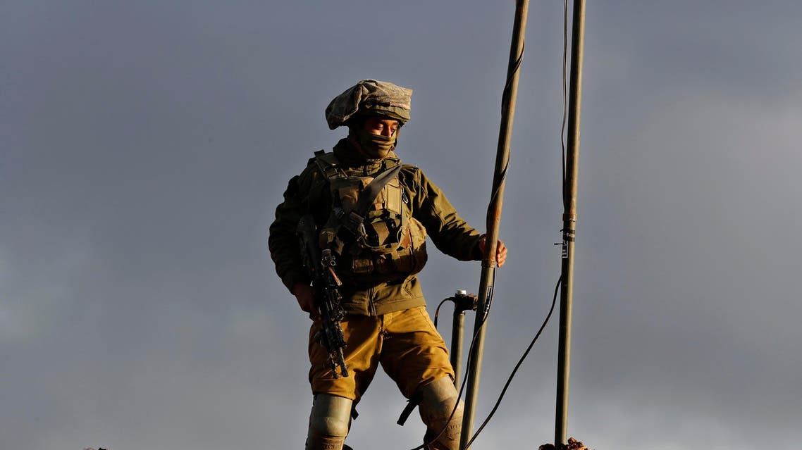 An Israeli soldier sets up a camera at one of their new position, near the Lebanese southern border village of Mays al-Jabal, Lebanon, on Dec. 13, 2018. (AP)