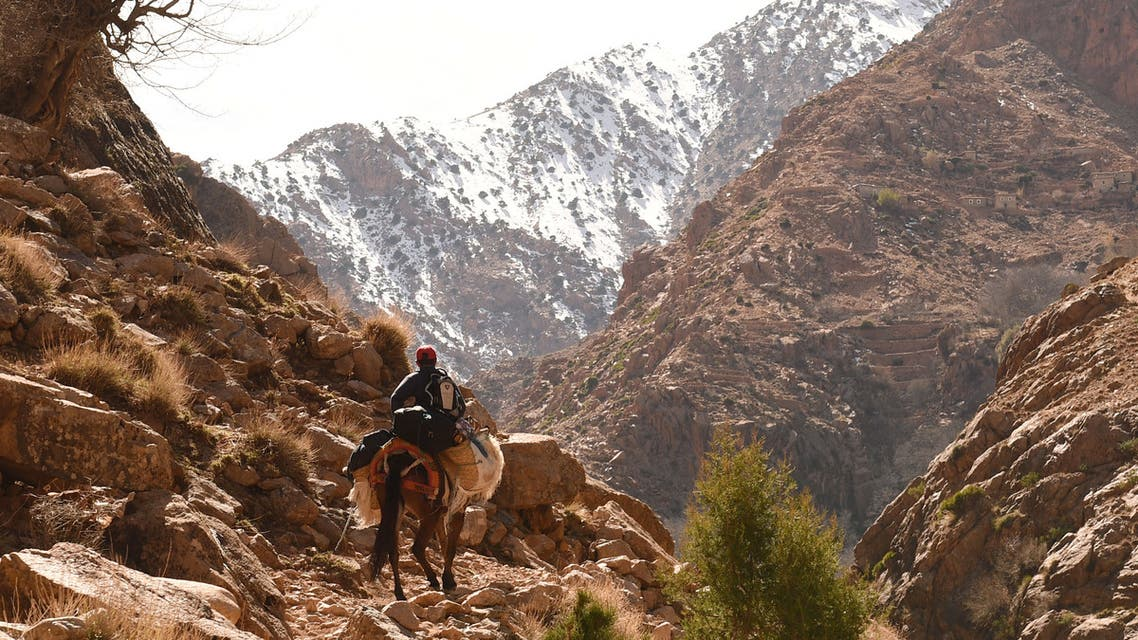 A Morroccan man on his donkey heads to his village Taghzirt, in el-Haouz province in the High Atlas Mountains south of the capital of Marrakech, on March 3, 2016. When using well-known search engines, one can find very few information about Taghzirt village. And while tourists from all around the world enjoy the sun warm days and the snow-covered view of the nearby mountains from Marrakesh, hundreds of villagers suffer from the harshness of winter and isolation, due to the state of the roads leading to it. Many villagers find it hard to access food, medical health and education.