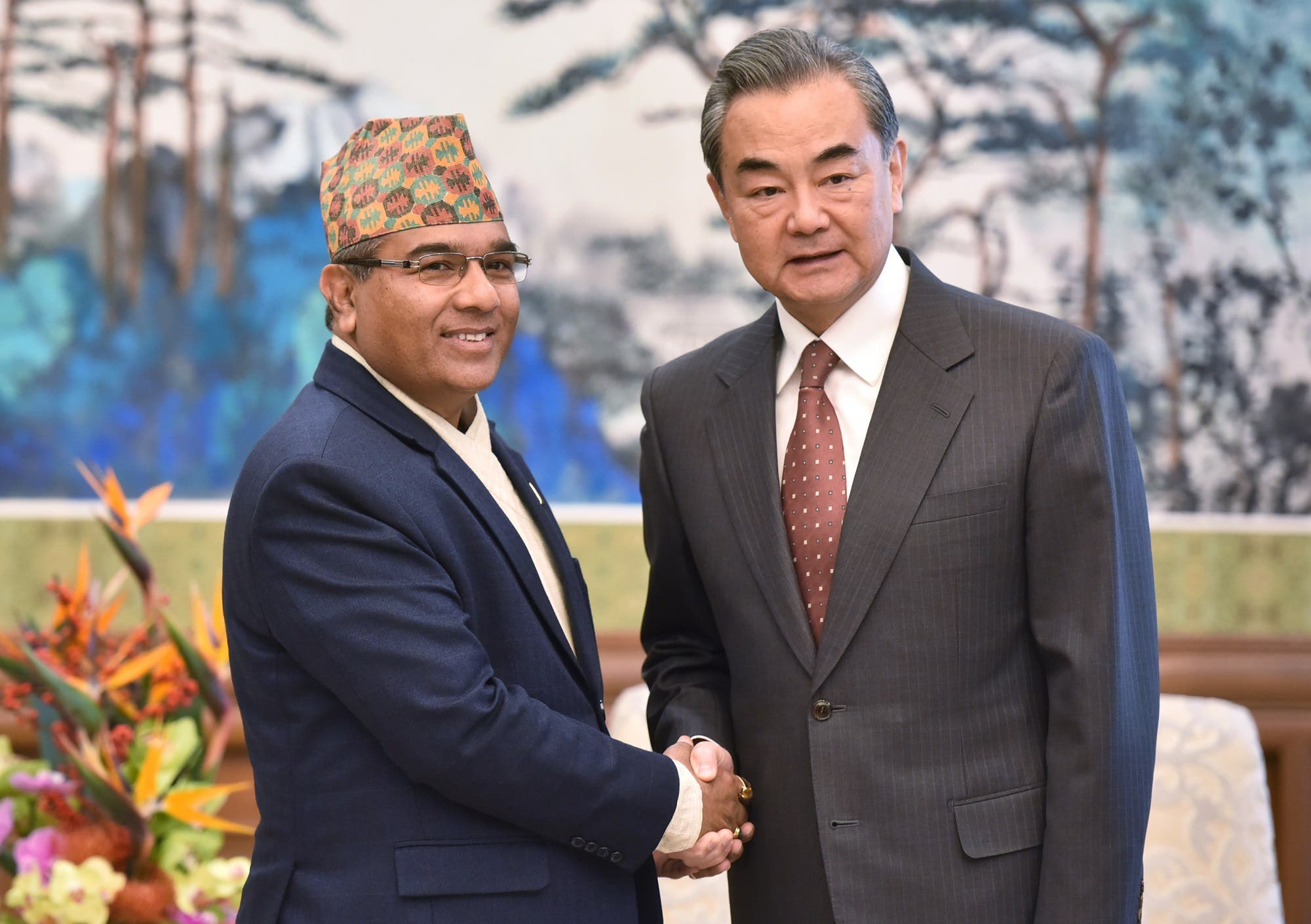 Nepal's Foreign Secretary Shankar Das Bairagi (L) shakes hands with Chinese Foreign Minister Wang Yi in Beijing on December 13, 2018. (AFP)