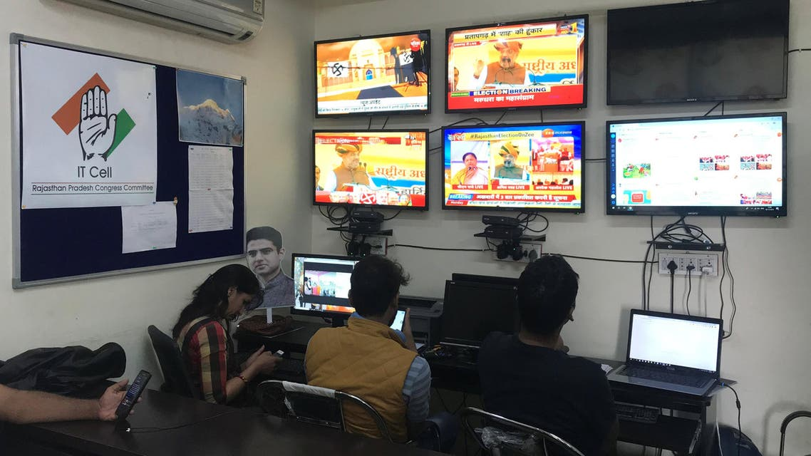 Volunteers of India's Congress party monitor TV news channels and social media inside their war room in Jaipur on December 3, 2018. (Reuters)