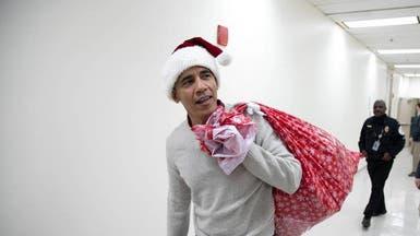 شاهد أوباما متنكراً يفاجئ الأطفال المرضى بالهدايا