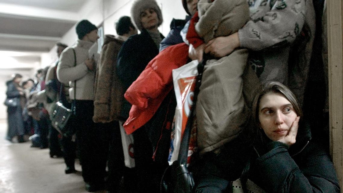 A Romanian woman at the International Office for Migration in Bucharest, Romania, on Jan. 28, 2004, waiting in a line to apply for a job in Spain. (AP)