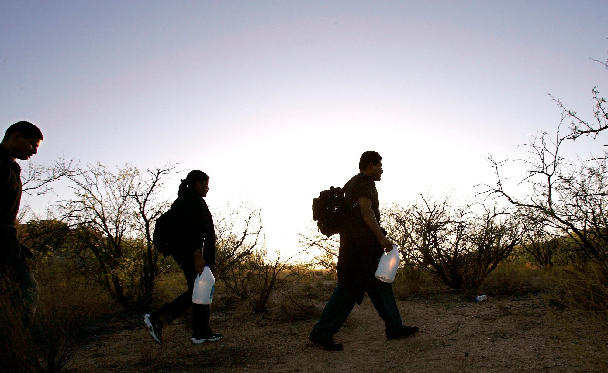 A group of migrants cross the desert between Sasabe, Mexico, and Sasabe, Arizona on April 25, 2006. (AP)