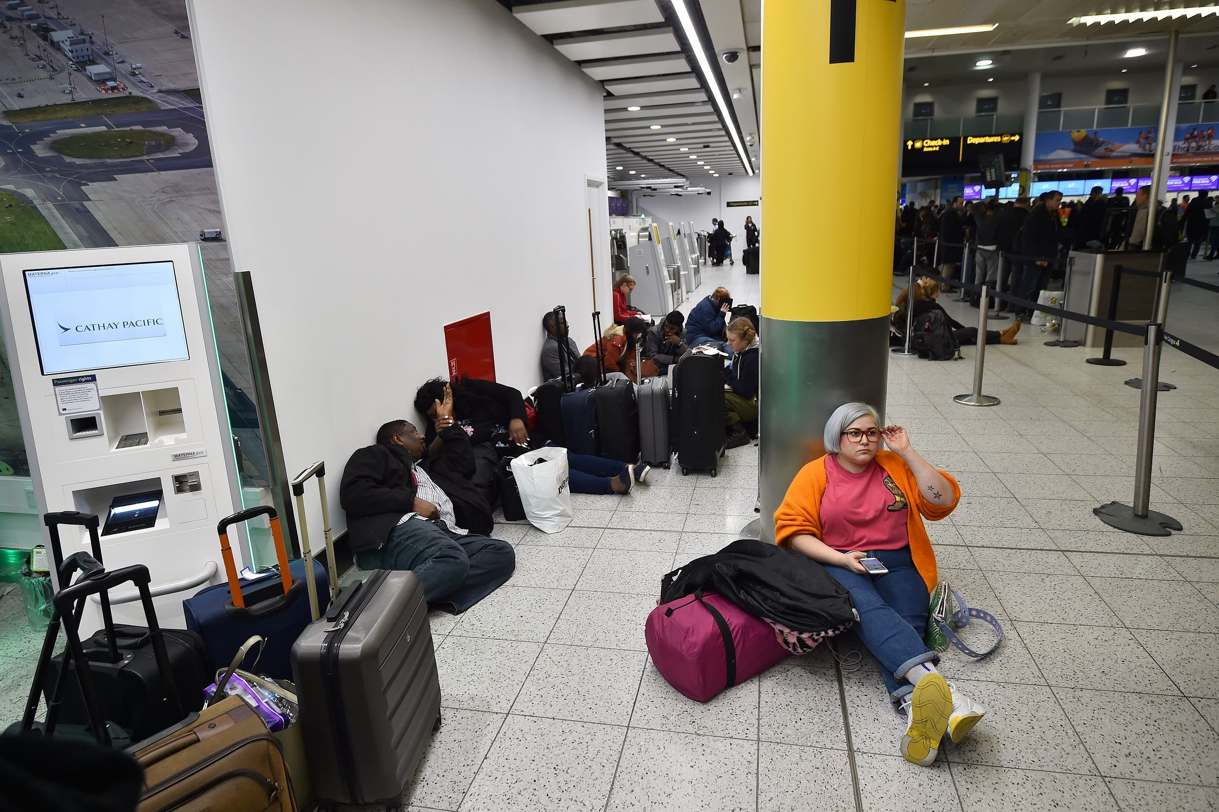 Passengers wait at London Gatwick Airport on December 20, 2018 after all flights were grounded. (AFP)