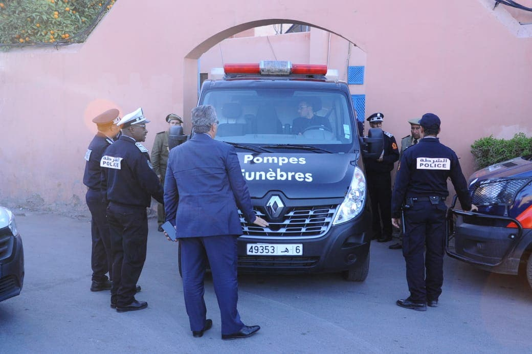 A picture taken on December 20, 2018, shows Moroccan police officers waiting outside a morgue in the capital Marrakesh, ahead of the transportation of the bodies of the two murdered Scandinavian hikers to the airport. (AFP)