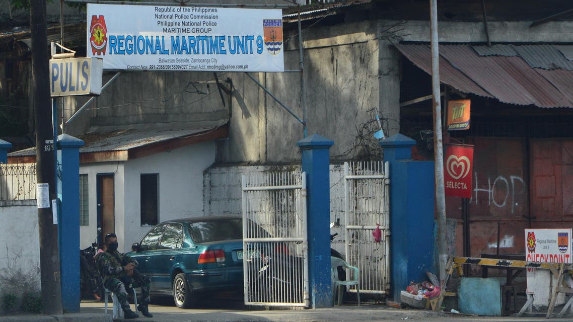 A Philippine National Police officer on guard at the Maritime Police Detachment in Mindanao days after Martial Law was extended in Mindanao until 2019. (Supplied)