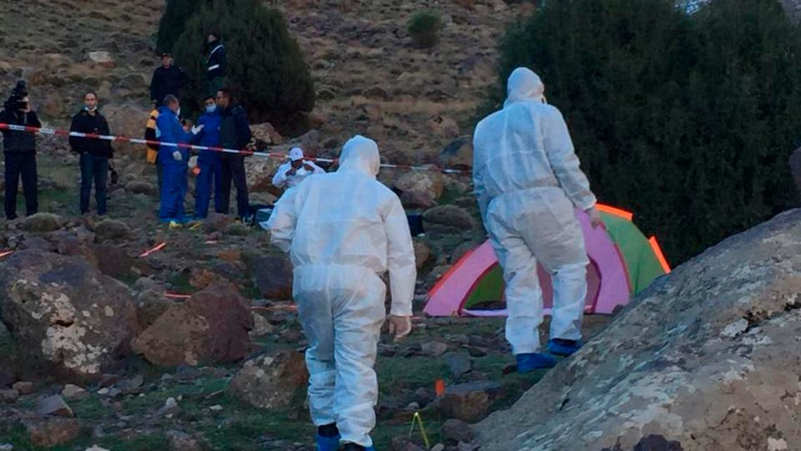 In this photo provided by Moroccan news channel 2M and taken on Tuesday, Dec. 18, 2018, a forensic team is seen at the area where the bodies of two Scandinavian women tourists were found dead. (AP)