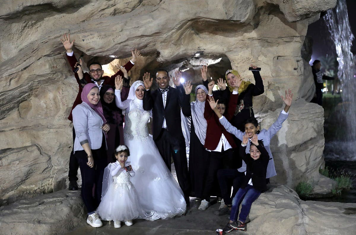 Nadia Mohammad Salem and her husband celebrate with family on their wedding day, in Cairo. (Reuters)