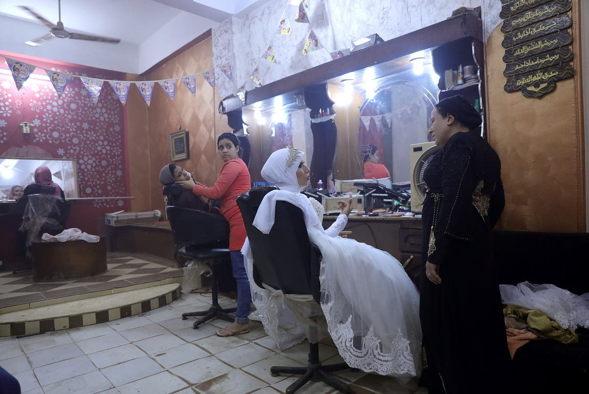 Nadia Mohammad Salem is seen at a hair salon on her wedding day, in Cairo. (Reuters)