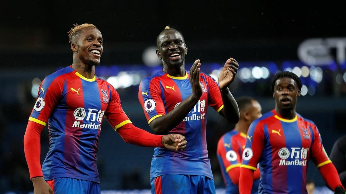 Crystal Palace's Wilfried Zaha and Mamadou Sakho celebrate after the match. (Reuters)