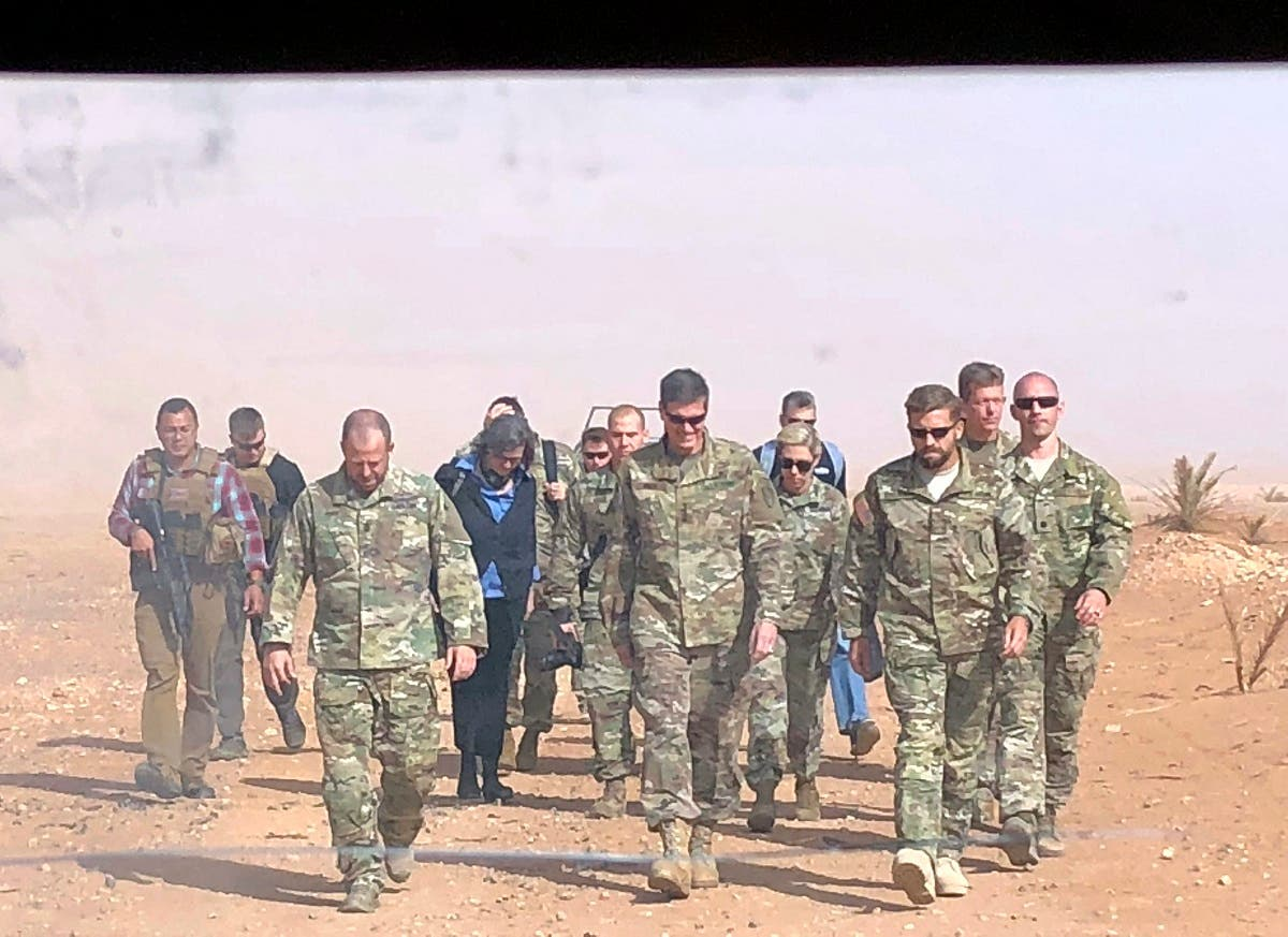 In this image made through a vehicle window, U.S. Gen. Joseph Votel, the top U.S. commander in the Middle East, center, arrives for an unannounced visit Monday, Oct. 22, 2018, at the al-Tanf military outpost in southern Syria. (File photo: AP)