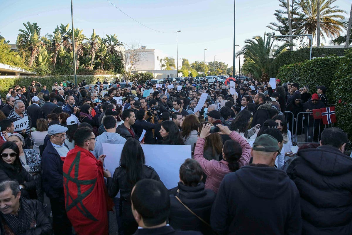 Moroccans hold vigil for slain Scandinavian tourists. (AP)