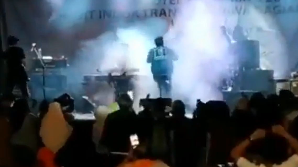 Dramatic video posted online showed the tsunami that struck Indonesia smashing into an open-air concert. (Screengrab)