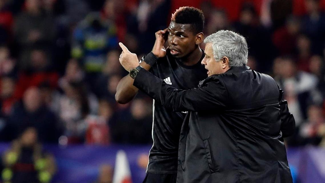 Manchester United manager Jose Mourinho, right, talks to Manchester United's Paul Pogba during the Champions League round of sixteen first leg match. (File photo: AP)