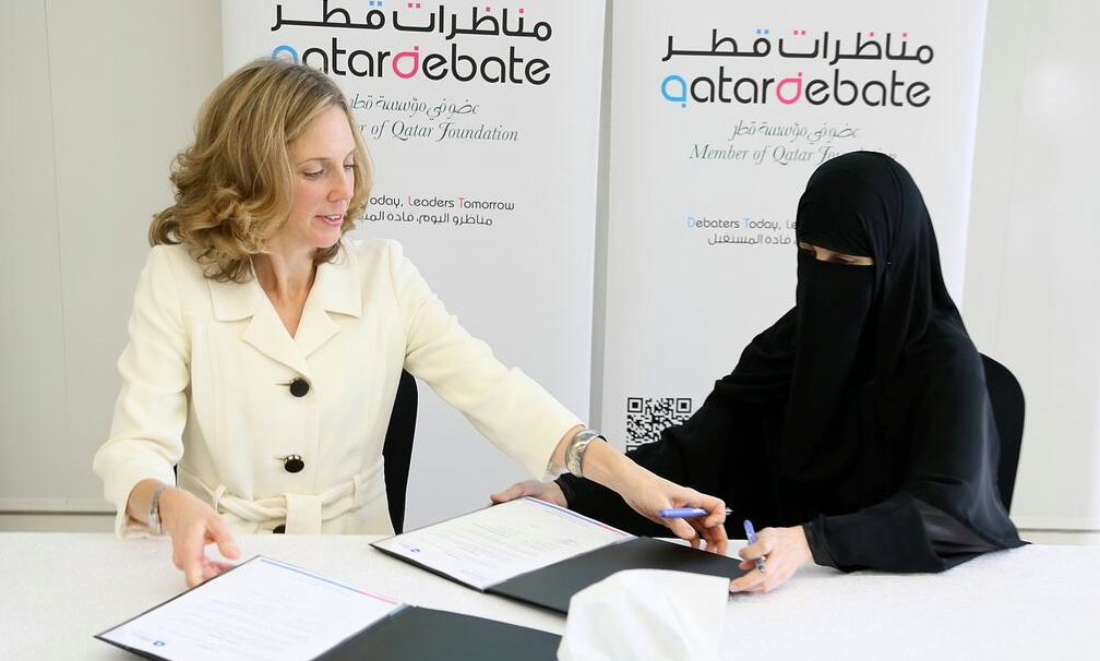 Qatar Foundation International's Executive Director, Maggie Mitchell Salem, signed a collaboration agreement in Doha yesterday with the Executive Director of QatarDebate, Dr. Hayat Maraafi. (Photo via Qatar Foundation International/Facebook)