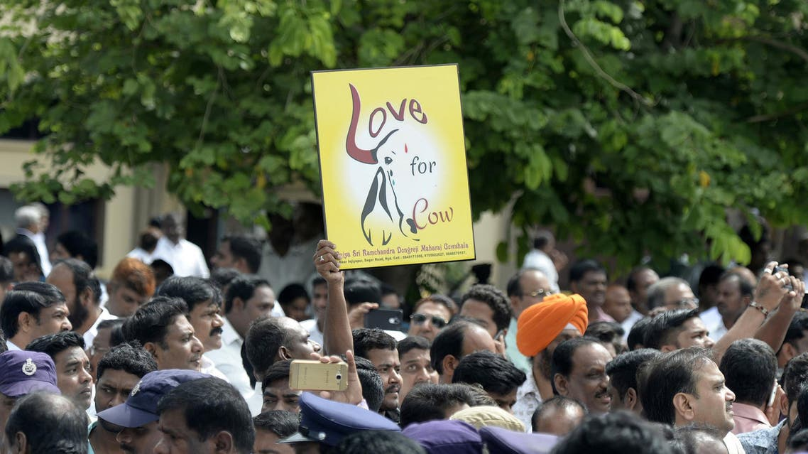 A BJP supporter holds a sign depicting a cow ahead of a meeting with cabinet members in Hyderabad on July 4, 2017. (AFP)