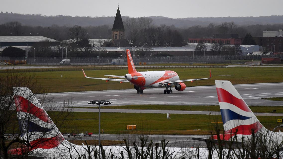 An EasyJet aircraft prepares to take off from the runway at London Gatwick Airport on December 21, 2018. (AFP)