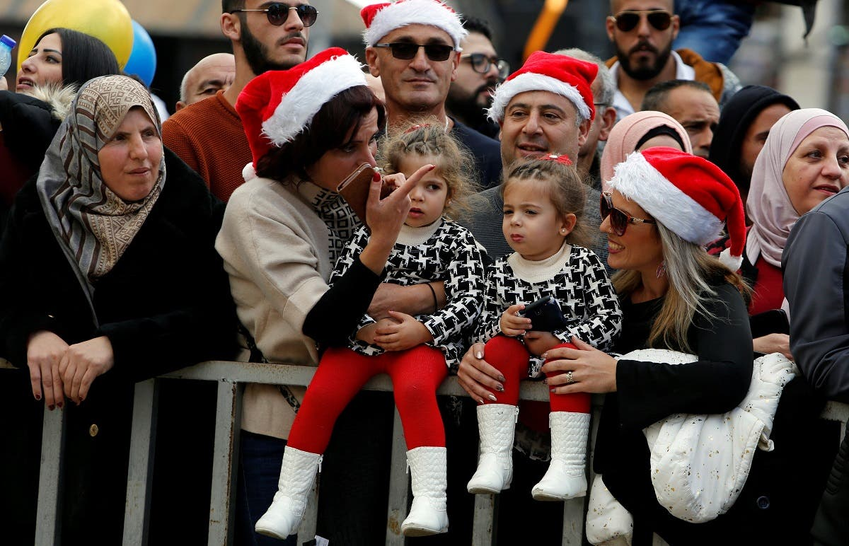 People attend Christmas celebrations at Manger Square outside the Church of the Nativity in Bethlehem, in the Israeli-occupied West Bank. (Reuters)