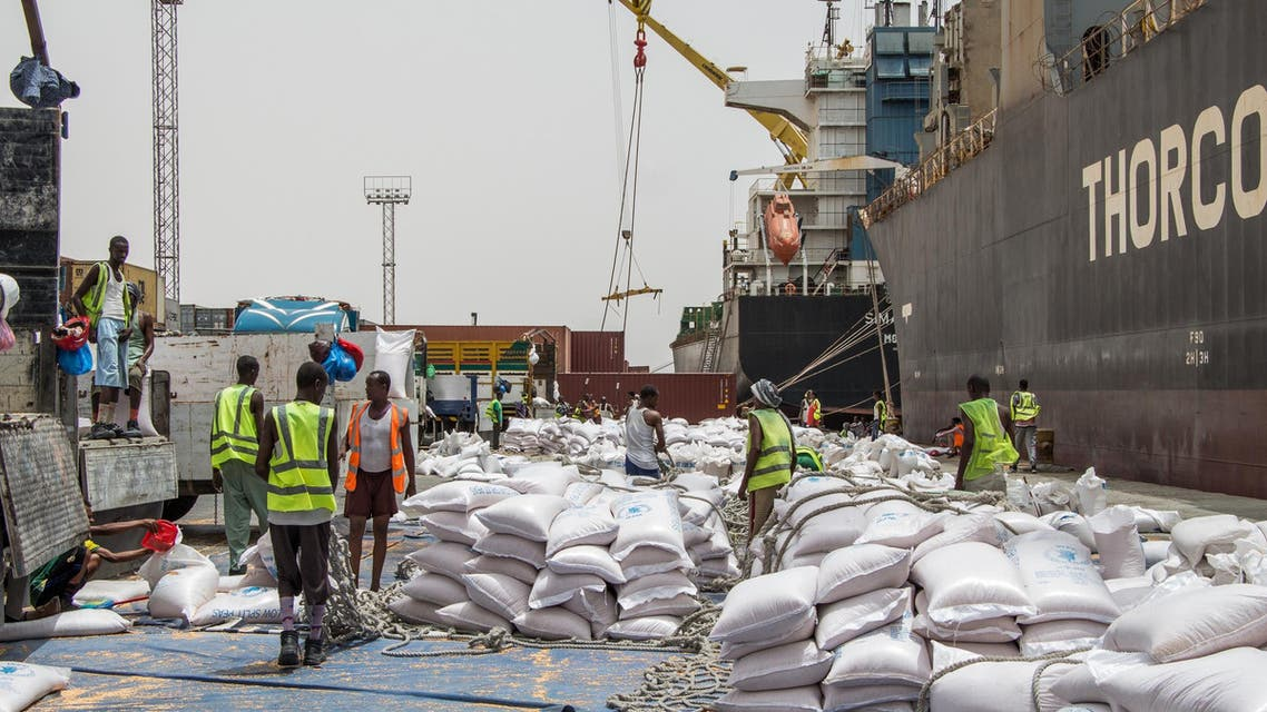 Workers unload NOGs' food ratios from the Thorco Liva ship before loading trucks at Berbera port of Somaliland on July 21, 2018. (AFP)