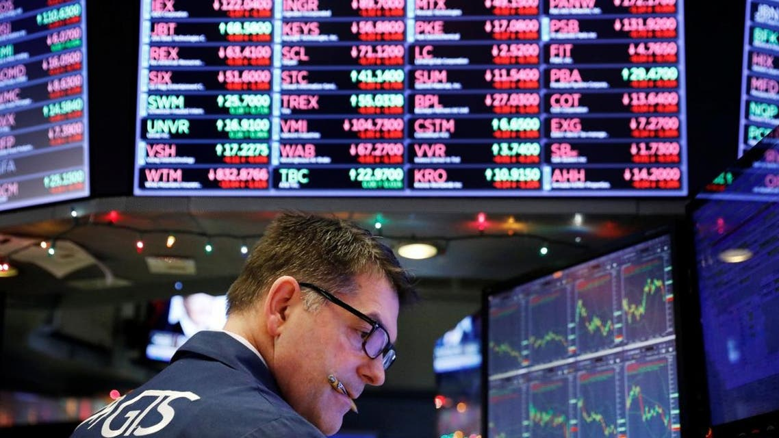 A trader works on the floor of the New York Stock Exchange shortly after the opening bell in New York. (Reuters)