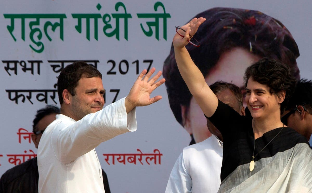 Congress party Vice President Rahul Gandhi, left, and his sister Priyanka Vadra wave to supporters during an election campaign rally in Rae Barelli 2017. (AP)