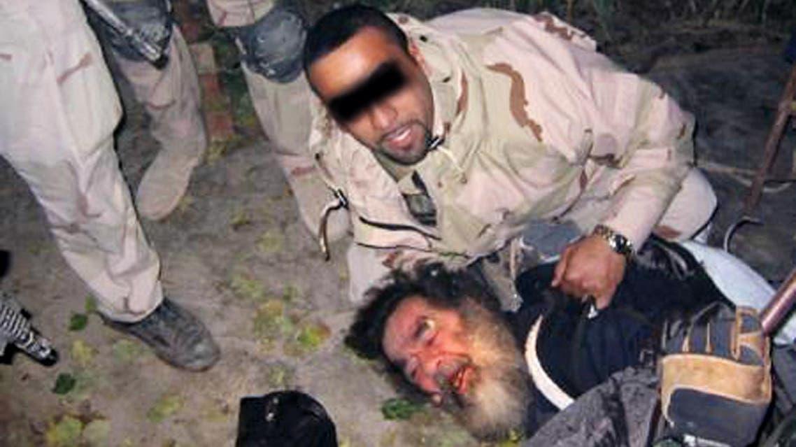 Saddam Hussein and translator Samir. (AFP)