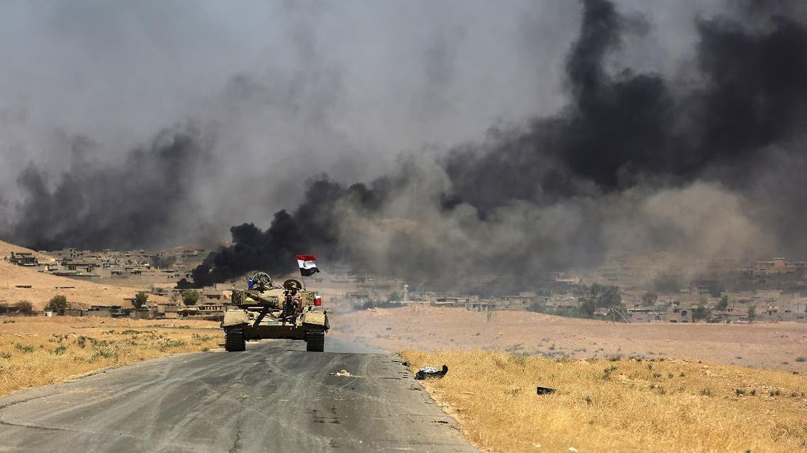 Smoke billows from the village of al-Ayadieh, near Qubuq, north of Tal Afar, as Iraqi forces advance during the ongoing operation to retake the area from the Islamic State (IS) group on August 28, 2017. (AFP)
