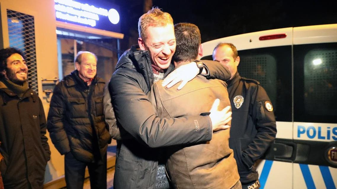 Austrian journalist Max Zirngast hugs a relative as he is released from Sincan prison in Ankara on December 24, 2018. (AFP)