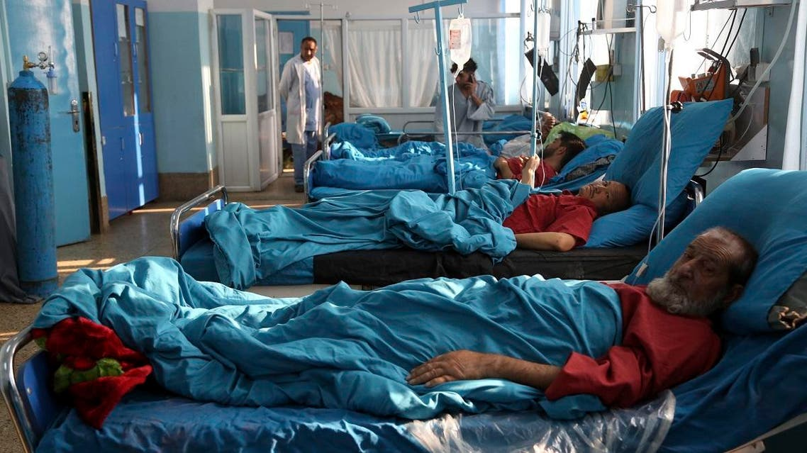 Injured men receive treatment at a hospital after Monday's Christmas Eve attack, in Kabul, Afghanistan, Tuesday, Dec. 25, 2018. A suicide bomber and gunmen armed with assault rifles and explosives attacked the building in Kabul on Monday, setting off an eight-hour-long siege. (AP)