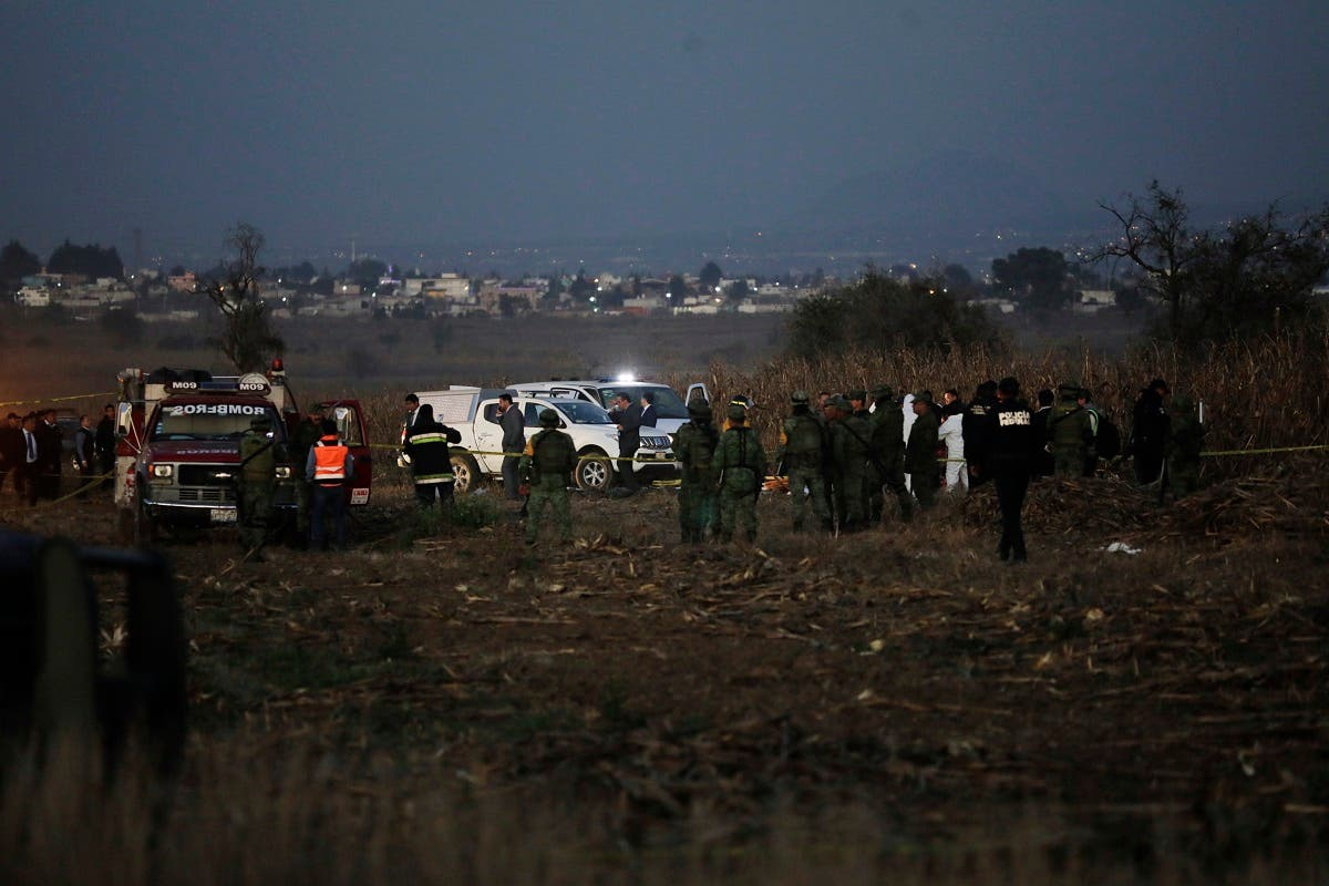 Emergency rescue personnel, the army and the police arrive to the scene of a helicopter crash where Puebla Gov. Martha Erika Alonso and her husband Rafael Moreno Valle, a former Puebla governor, died near Puebla City, southeast of Mexico City on Monday, Dec. 24, 2018. (AP)