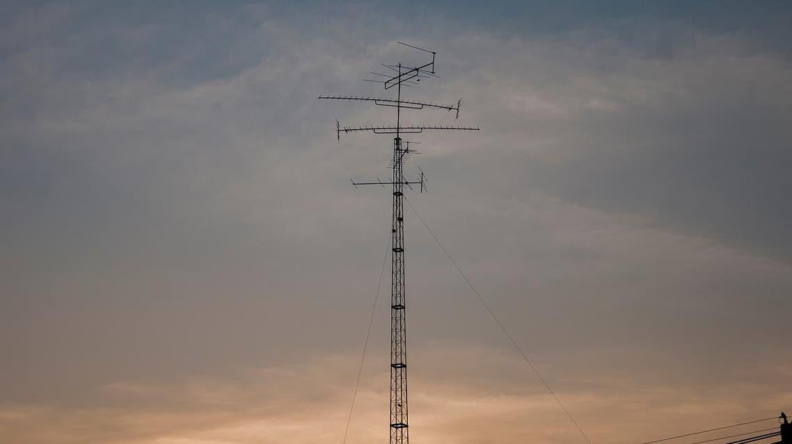 Telecommunication tower mast TV antennas. (Shutterstock)