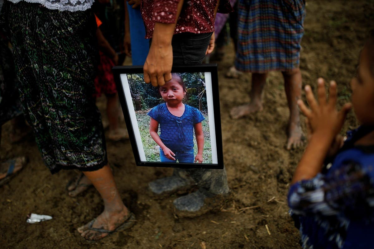 A man holds a picture of Jakelin Caal during her funeral at her home village of San Antonio Secortez, in Guatemala. (Reuters)