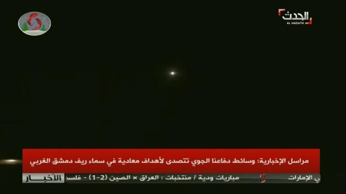 """State television Al-Ekhbariya carried a breaking ticker saying air defenses had intercepted missiles. But it only referred to """"hostile targets"""" in a later report."""
