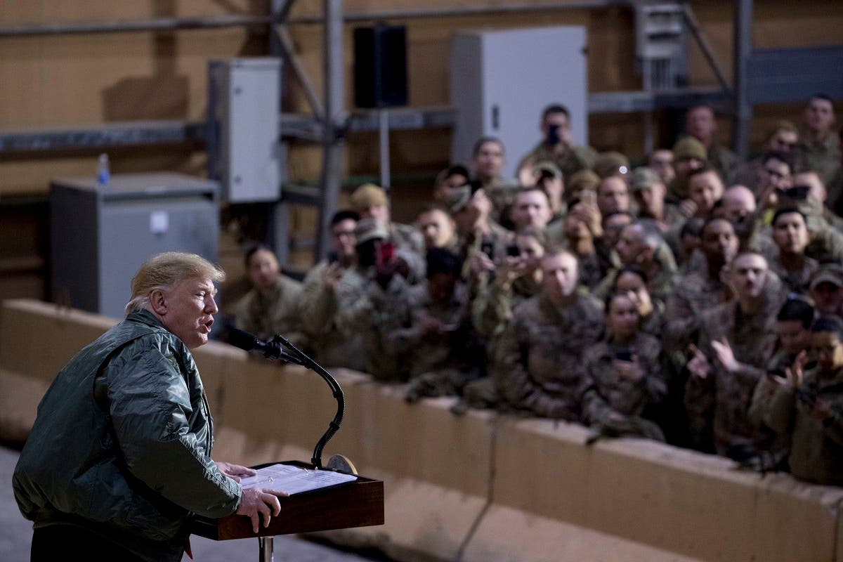 Trump visits US troops in Iraq. (AP)